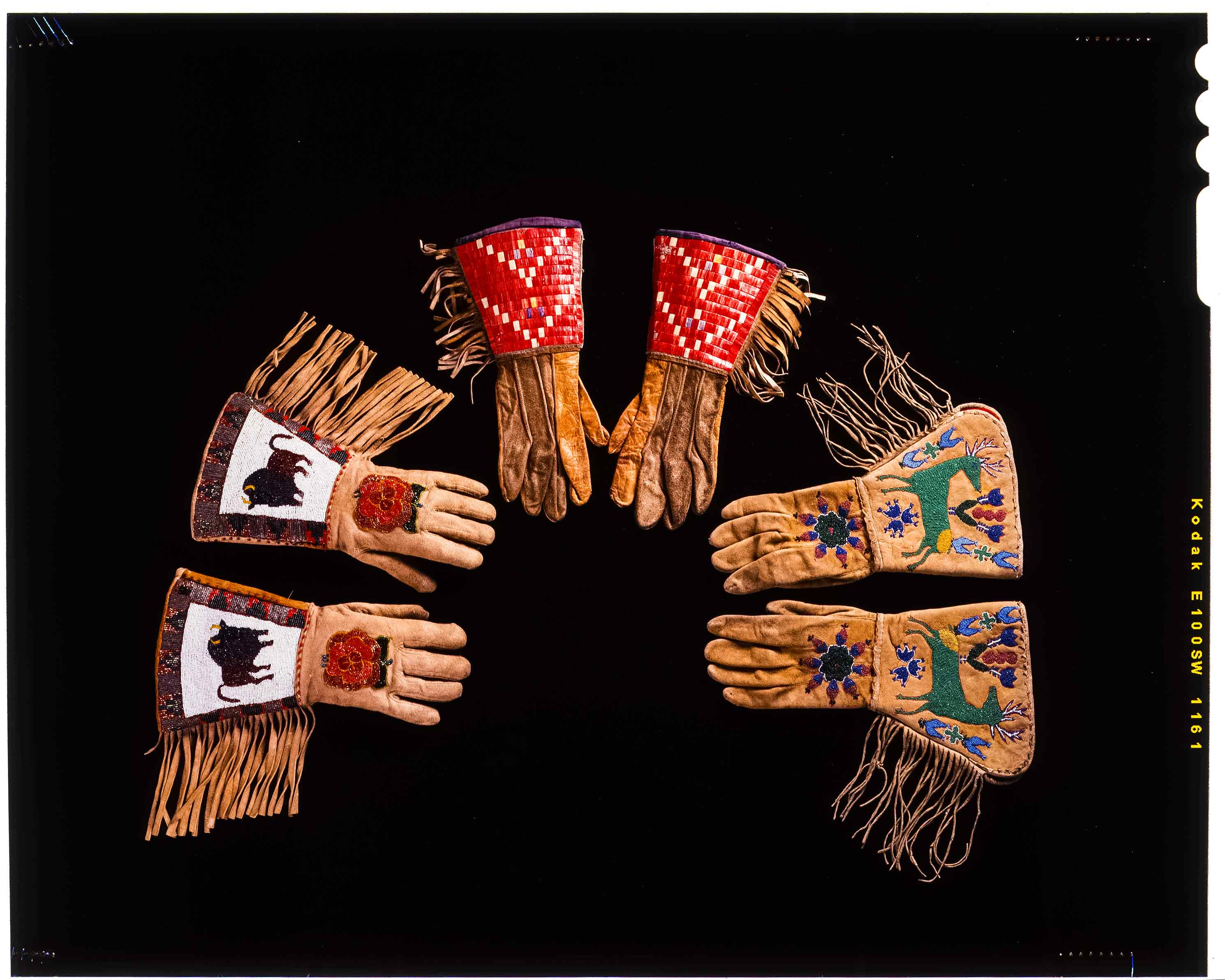 Leather beaded gauntlets with fringe and beaded  buffalo, chevron and deer patterns  c. 1930s
