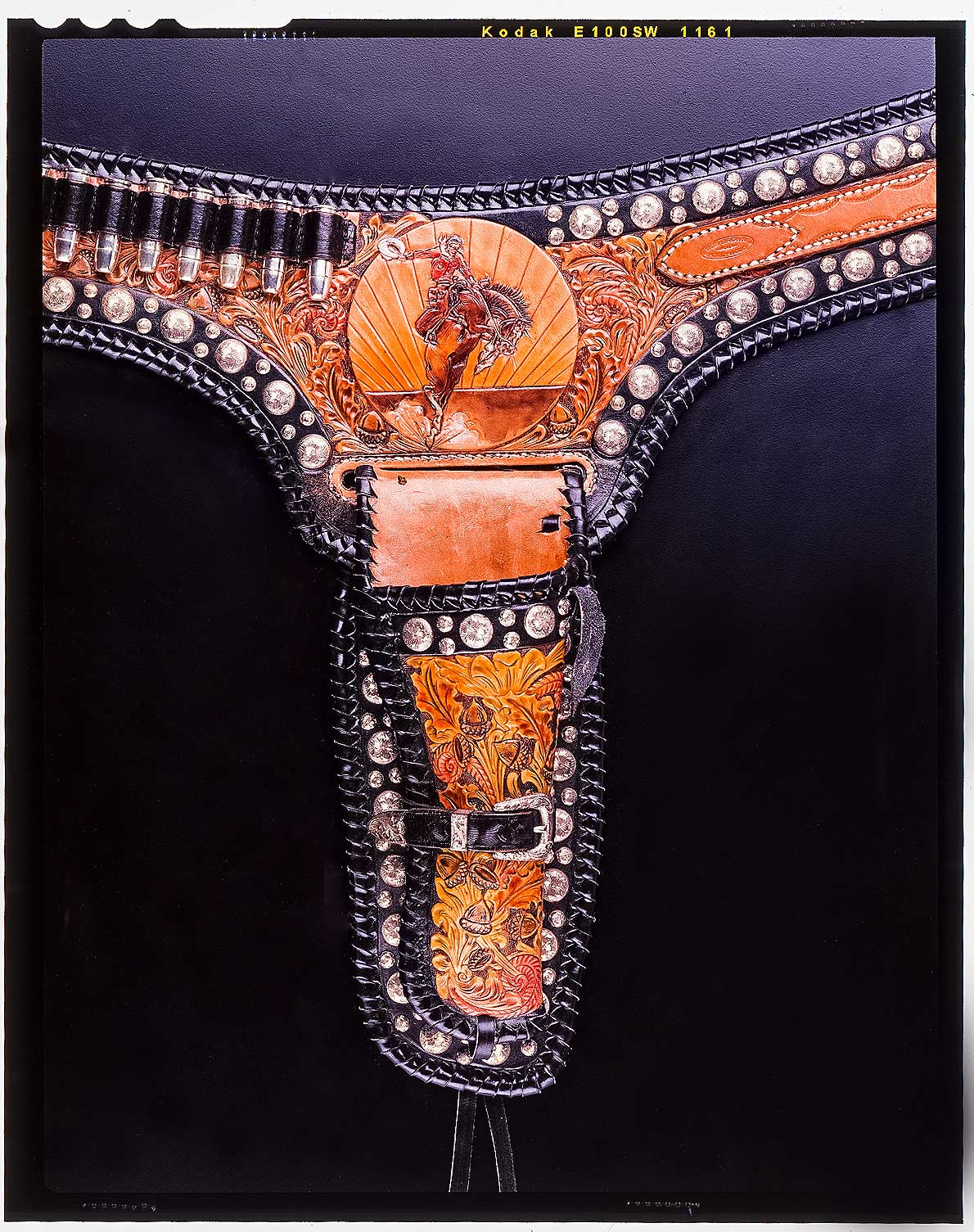 Gun belt -   Figure of Bronc rider taken from C.M. Russel